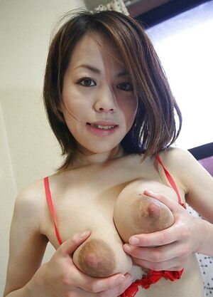 Beautiful Japanese babe lactating her tits